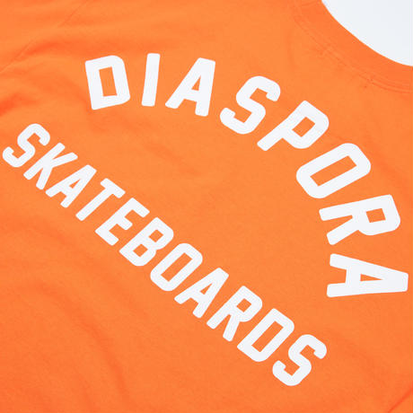 "Jazzy Sport x Diaspora skateboards  ""SYMBIOSIS"" TEE (Orange)"