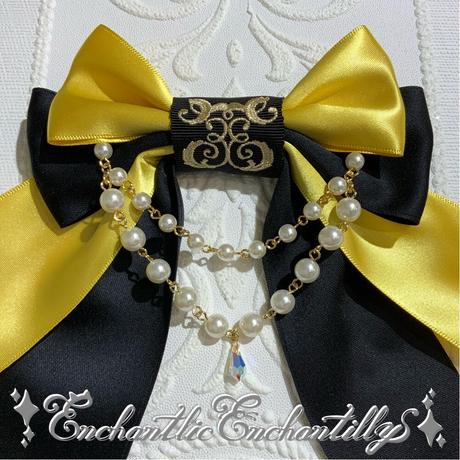 ロゴ刺繍パールリボンブローチ(黄蜜蜂×黒)