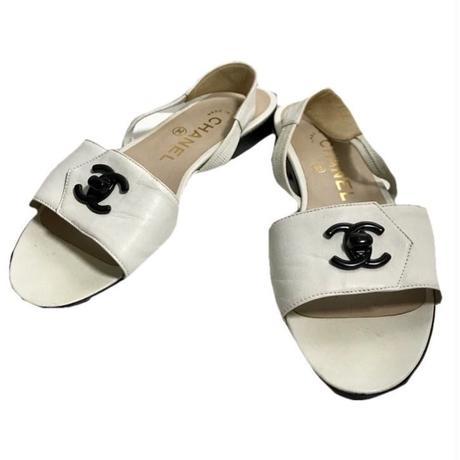 CHANEL black coco buckle sandal white