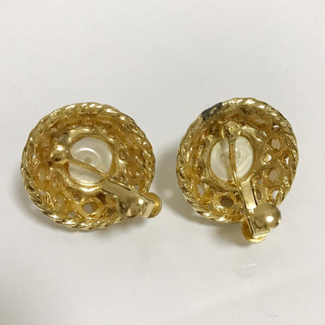 round pearl design earrings