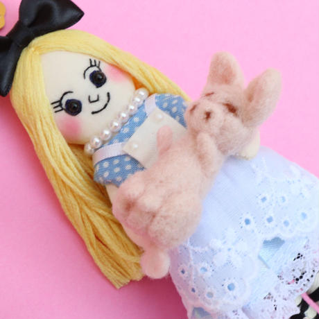Alice Holding A  Piglet Doll Charm