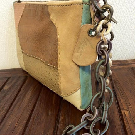 Clutch bag with a chain of Italian beads
