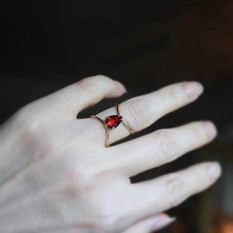 Infinity ring set with a garnet