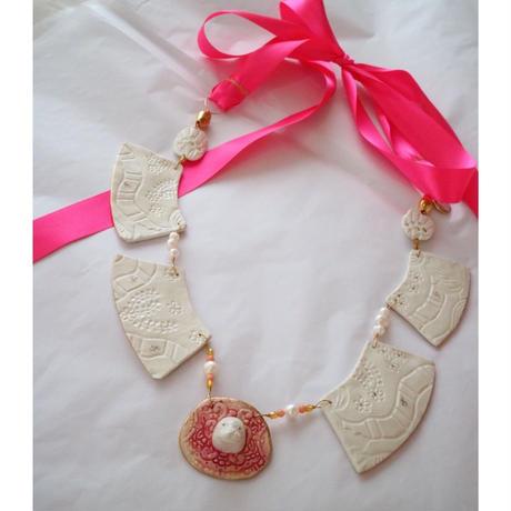 Joke Schole ceramic necklace  pink ribbon