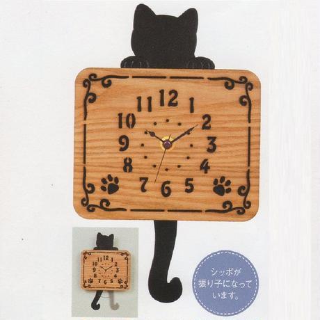 しっぽがひょいひょい揺れるよん♪黒猫木製振子時計☆問屋直送品です。