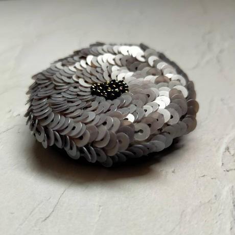 grey flower brooch
