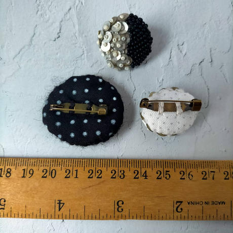 white moon brooch