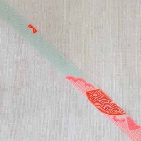 白にオレンジの吉祥柄と小花・モスリン2m