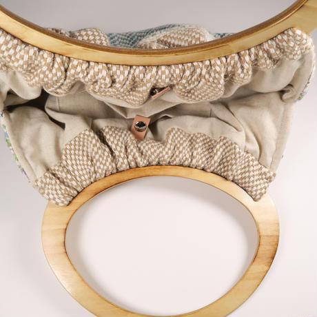手織り裂き布織込みハンドバッグ、trois temps