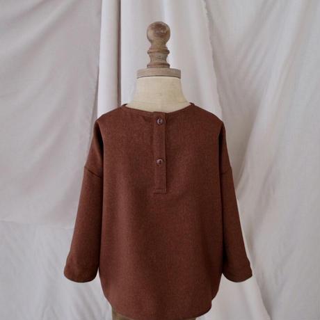 Piping pullover / brick