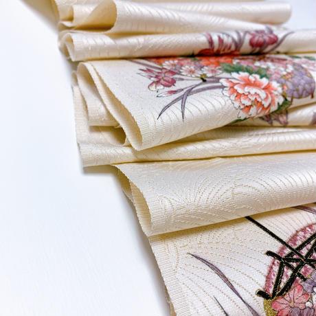 銀金糸通し糸巻きと古典草花模様金糸総地紋【タックラップスカート】