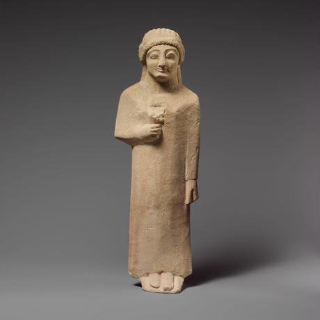 Limestone statuette of a female votary holding a flower (soft toy)