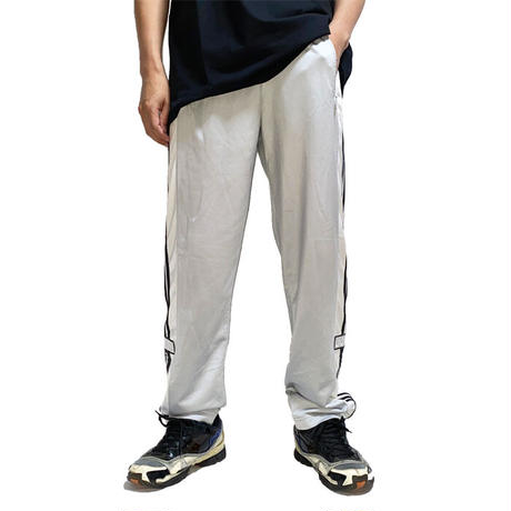 【USED】90'S ADIDAS SIDE SEAM SLITS WITH SNAP BUTTON TRACK PANTS SILVER