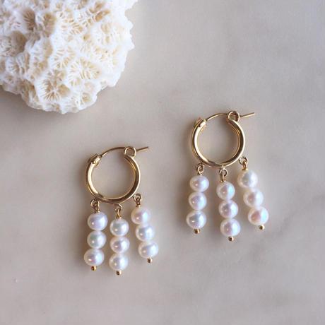 Pearl hoop pierced