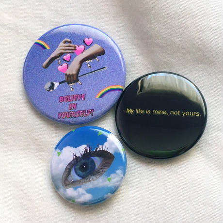 """WE LIVE IN THE SAME PLANET"" badge set"