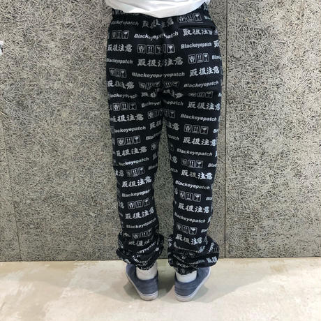 BLACK EYE PATCH HANDLE WITH CARE SWEAT PANTS BLACK