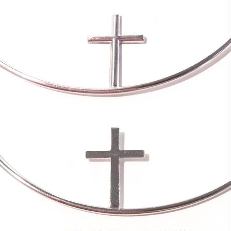 Cross hoop pierce