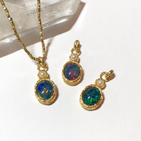 Tiny opal charm
