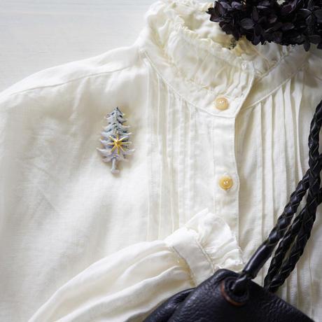 木と星金彩磁土ブローチ