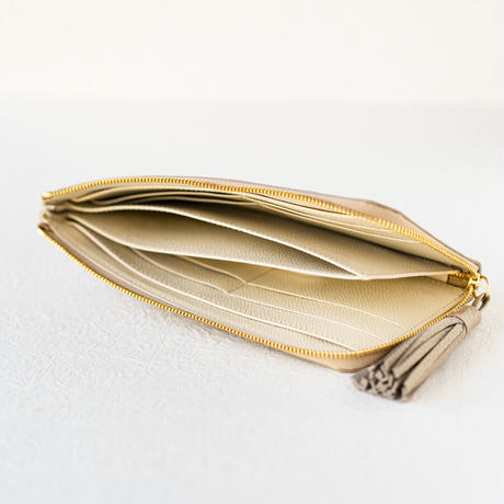 L字ファスナー長財布 タッセル付  トリヨンクレマンス/シャンパンゴールド×ヴォー・エプソン/クリーム