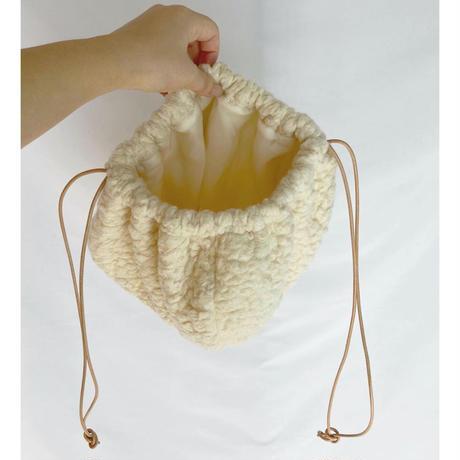 big pile draw string bag