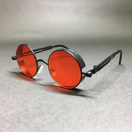 怪しげな紅丸い眼鏡