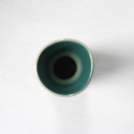green and cream ceramic vase