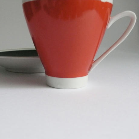 Red and black cup and saucer