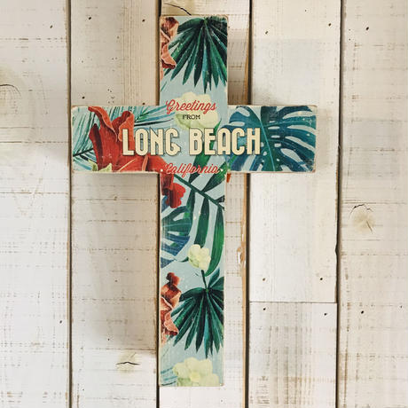 wood cross by sea shore