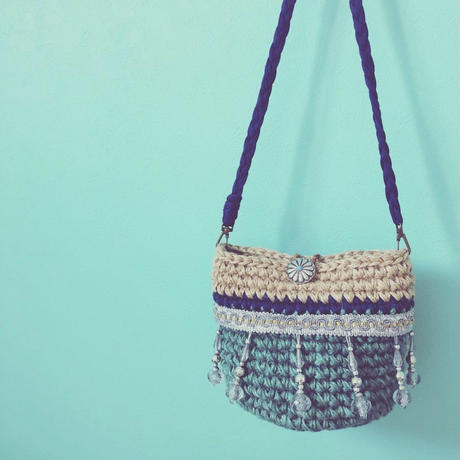 tassel pochette bag by drop