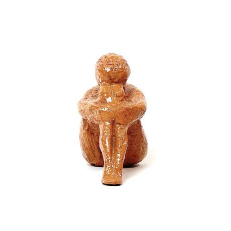 Sitting ceramic sculpture
