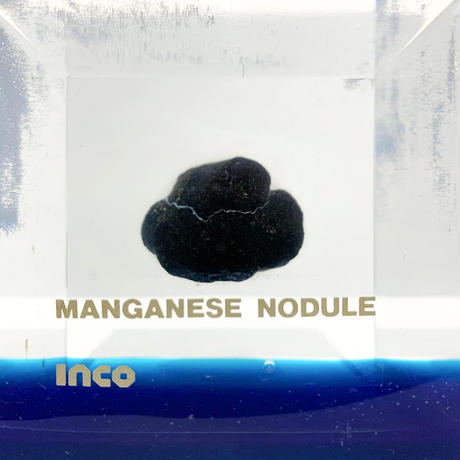 Manganese nodule lucite cube
