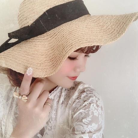 elegant black ribbon brimmed hat