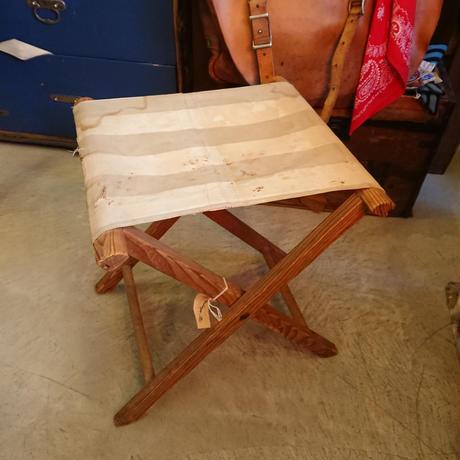 Folding wooden stool.  (White fabric)