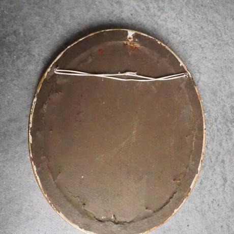 un cadre brodé  M
