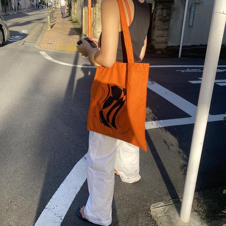 light is  worn brady orange tote bag