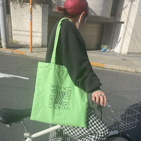 light is worn green tote bag