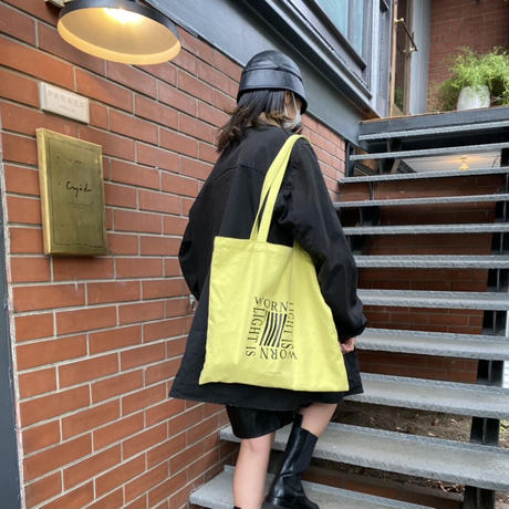 light is worn yellow tote bag