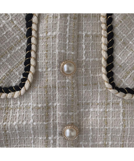 tweed pearl button mini skirt