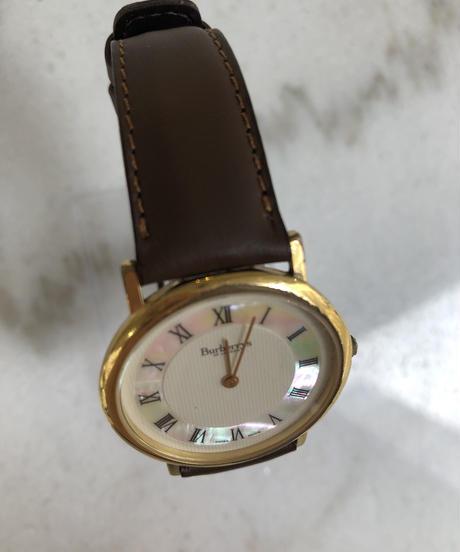 Burberry/ vintage gold round  quartz .075 (U)