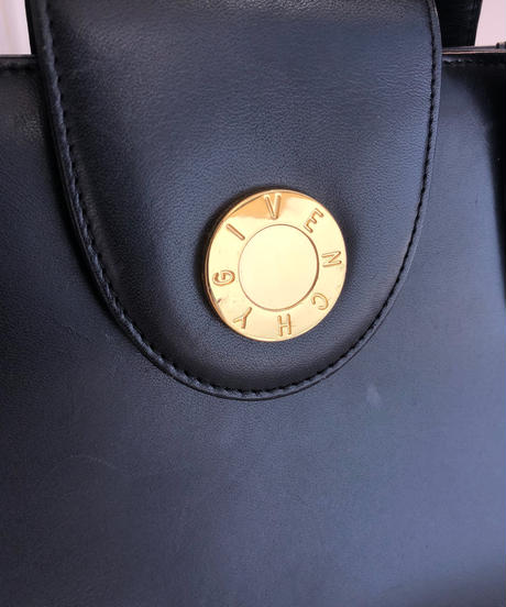 GIVENCHY/ gold buckle leather hand bag.