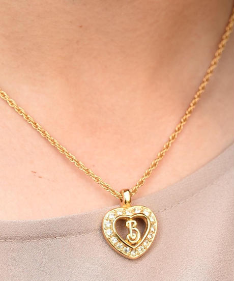 Burberry's/ heart  motif gold stone necklace