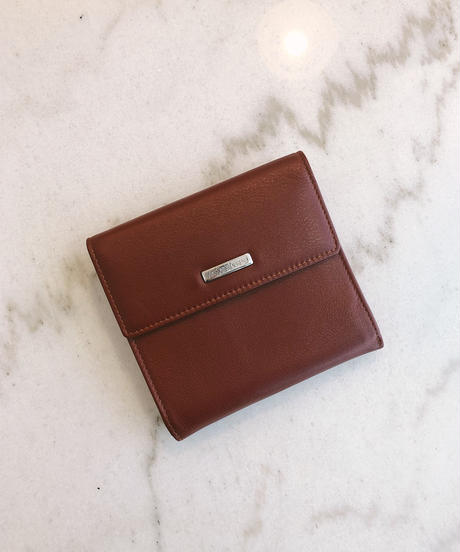 YvesSaintLaurent/ logo plate leather wallet.