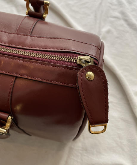 Cartier/vintage mustline boston bag.