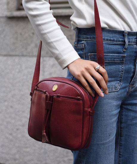 Cartier/vintage mustline tassel design shoulder bag.  (4)