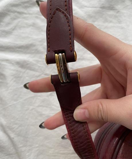 Cartier/vintage mustline tassel design shoulder bag.  (1)