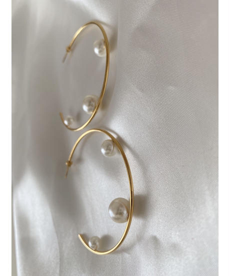 Hoop pearl pierce