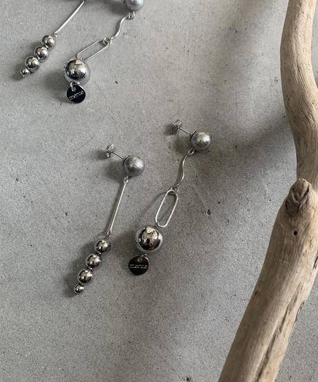 ball impression asymmetry silver earring