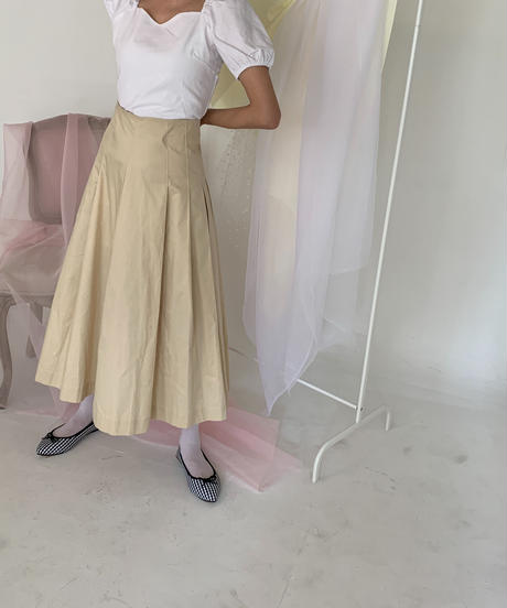 beige pleated long skirt