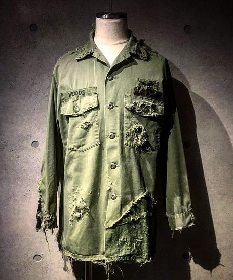 Different fabrics sewn hard damage military shirt